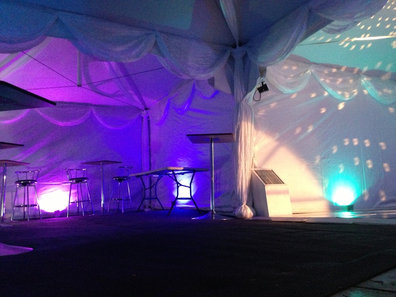 Marquee with uplighters and white drapes