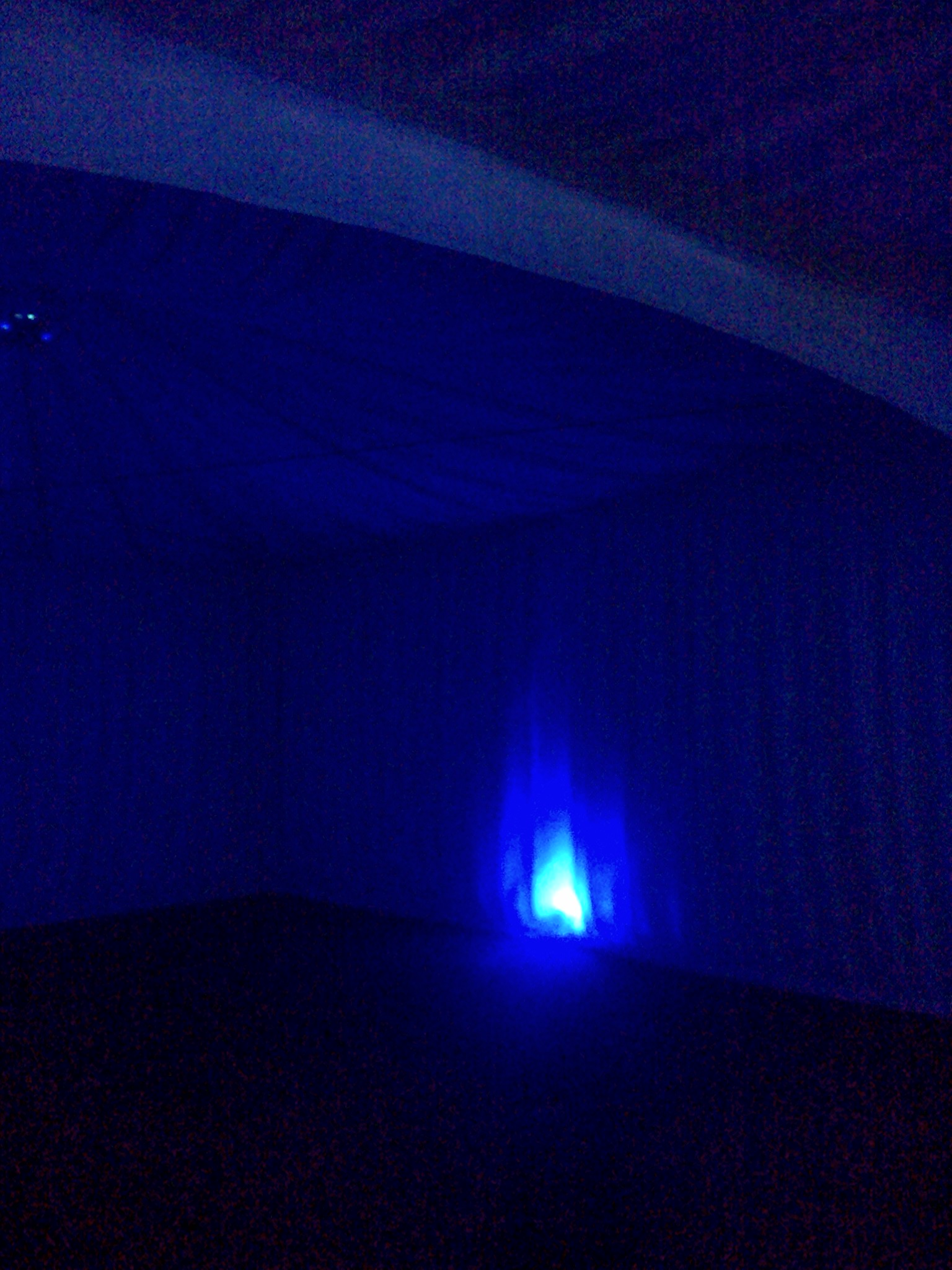 Blue lit  marquee with pleated linings